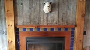 The fireplace at Shepherds Pub in Waitsfield