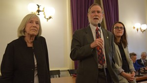 Rep. Dave Sharpe addresses the Democratic caucus Thursday as Rep. Janet Ancel, left, and Rep. Jill Krowinski look on.
