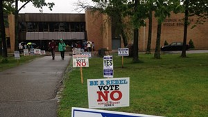 Signs outside Frederick H. Tuttle Middle School in South Burlington Tuesday