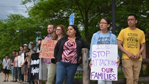 Supporters protest the arrests of Esau Peche-Ventura and Yesenia Hernández-Ramos outside the Chittenden Regional Correctional Facility.