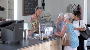 Diane Elliott Gayer serving visitors at GreenTARA Space
