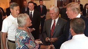 Marianne Dubie greets President Donald Trump and Vice President Mike Pence at the White House on Monday as Brian Dubie (left) and Mark Dubie (right) look on.