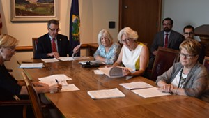Gov. Phil Scott and legislators who make up the Emergency Board meet Friday in Montpelier to discuss state revenues.
