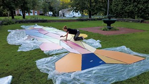 Mary Lacy painting components of her trout mural