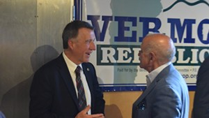 Gov. Phil Scott (left) talking to his former Republican primary rival, Bruce Lisman
