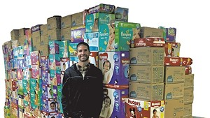 Fitzgerald in front of the wall of diapers