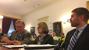 Public Utility Commission staff attorney John Cotter, PUC member Margaret Cheney and utilities analyst Tom Knauer testify before the Legislative Committee on Administrative Rules.