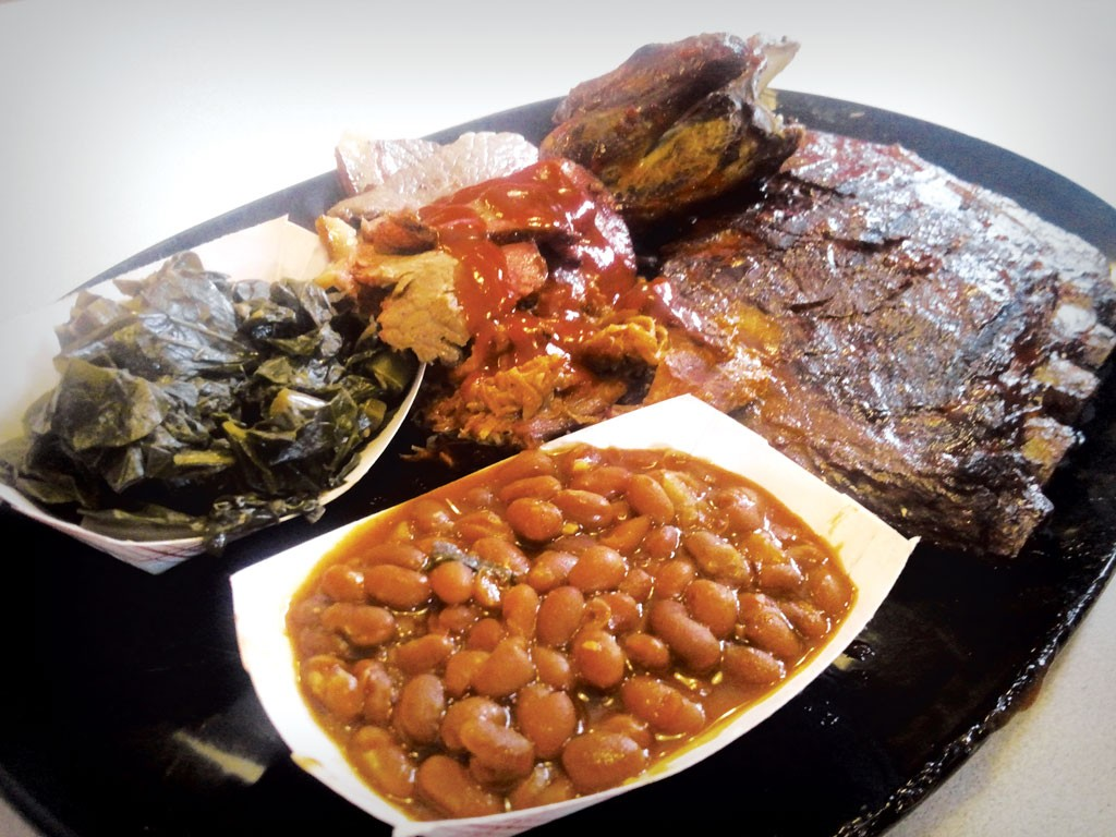 The BBQ Lovers Who Want It All dish at Tail O' the Pup - ETHAN DE SEIFE
