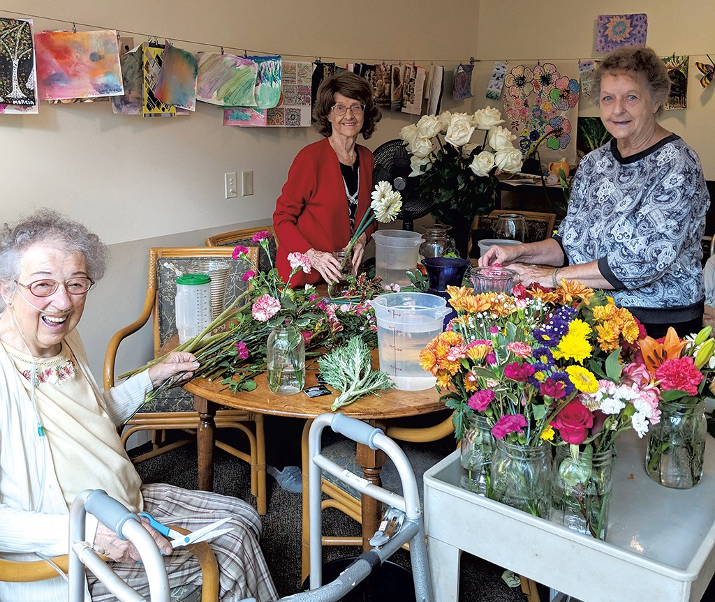 1019a729619b click to enlarge Residents arranging flowers from their garden - COURTESY  OF THE LIVING WELL GROUP