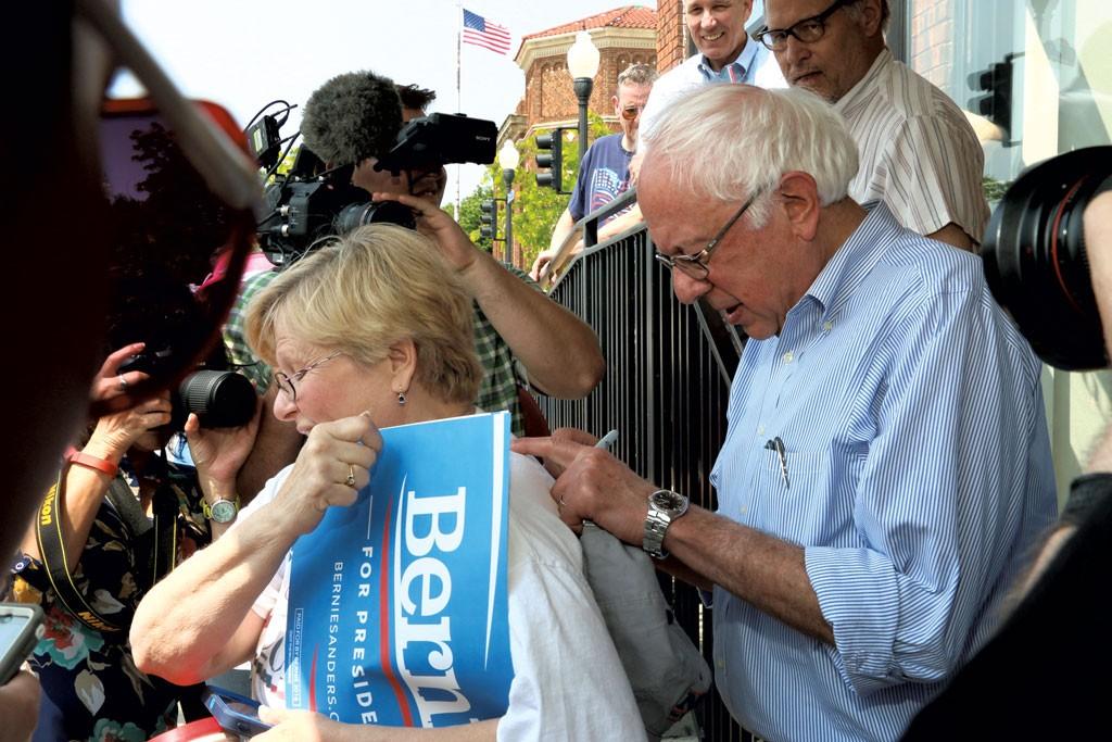Sanders signing Peggy Galletley's shirt in Denison, Iowa - DEBRA S. KAPLAN
