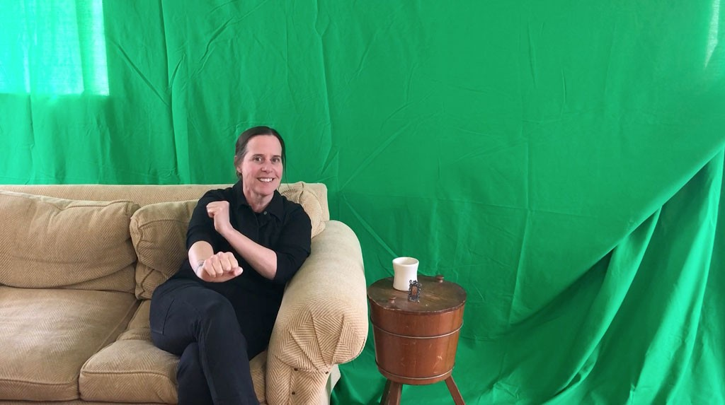 Kristen Mills with her green screen - COURTESY PHOTO