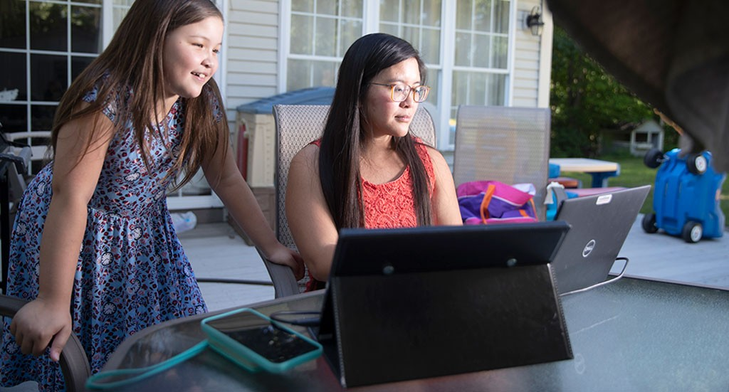 Cao working from home with her daughter - JAMES BUCK