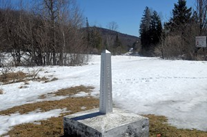 A small obelisk marks the U.S.-Canadian border in northern Vermont. - MARK DAVIS
