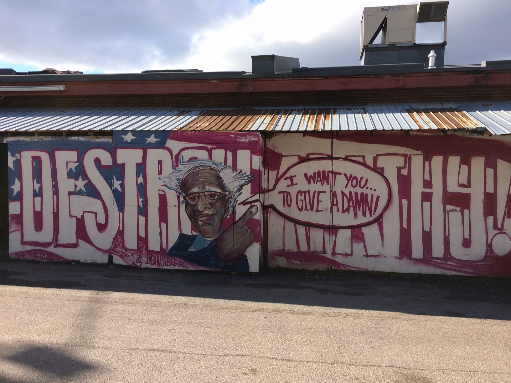 Click to enlarge anthill collectives bernie sanders mural behind artsriot courtesy of anthill collective