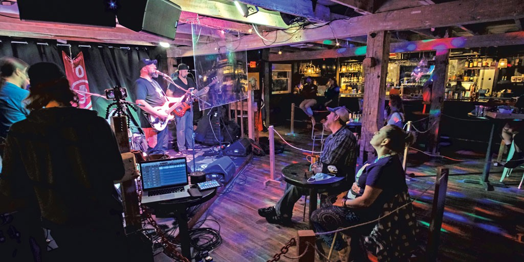 """Grateful Dead tribute band Shred is Dead performing to Zenbarn's """"party pods"""" - COURTESY OF SHAWN RICE"""