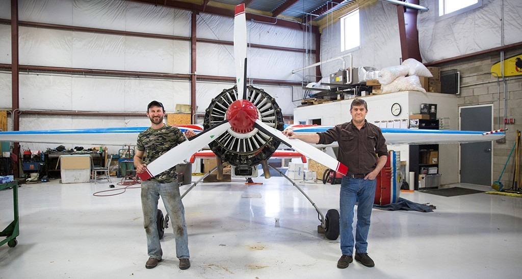 Dan Marcotte of Dan Marcotte Airshows (left) posing with Cliff Coy of Border Air in front of a Russian Yak-55 - JAMES BUCK