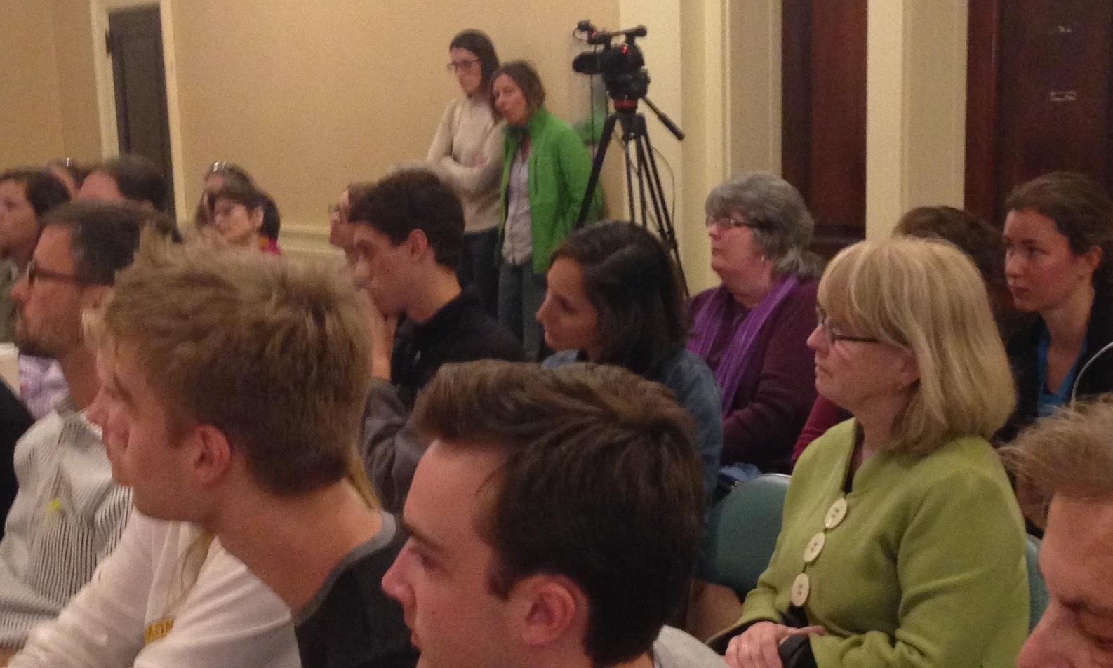 click to enlarge Amy Mellencamp, in green sweater, at a school board  meeting this spring - MOLLY