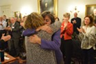 Reps. Mitzi Johnson, in purple, and Sarah Copeland Hanzas hug after Johnson won the vote to be the Democrats nominee for House speaker.