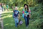 UVM senior Katlyn Williard and Flynn fifth grader Ivy spot a blue jay near the Burlington Bike Path