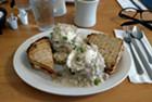 Potato cakes, poached eggs, ham-and-sausage gravy