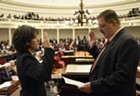 Rep. Mitzi Johnson (D-South Hero) is sworn in as House speaker Wednesday by Secretary of State Jim Condos.