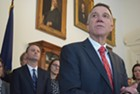 Gov. Phil Scott speaks last week about a bill to defy President Donald Trump's immigration order as Attorney General T.J. Donovan and others listen.