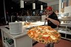 Griffeon Chuba with a hot pie at Pizzeria Verità