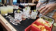 Bartenders Scramble at Lakeside Spot on the Dock