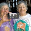 Cheesemakers Marjorie Susman (left) and Marian Pollack with a photo of themselves from the early days of Orb Weaver Farm
