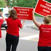 Nurses at a honk-and-wave rally outside the hospital