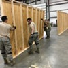 Vermont National Guard members erecting walls inside the exhibition hall