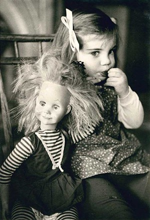 """COURTESY OF MAHANEY CENTER FOR THE ARTS - """"Portrait of Young Girl With Doll,"""" Jacques Lowe"""