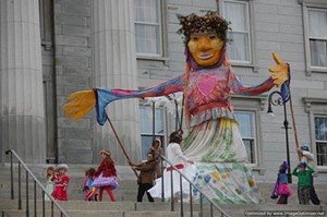 Earth Goddess emerges at the Statehouse as part of All Species Day. - Uploaded by Liza