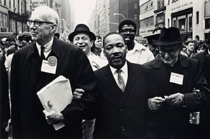 "COURTESY OF THE HYDE MUSEUM - ""Dr. Benjamin Spock, Dr. Martin Luther King Jr and Monsignor Rice of Pittsburgh March in the Solidarity Day Parade at the United National Building,"" photograph by Benedict J. Fernandez"