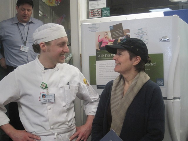 Waters (in a Fletcher Allen hat) with line chef Curtis Campbell