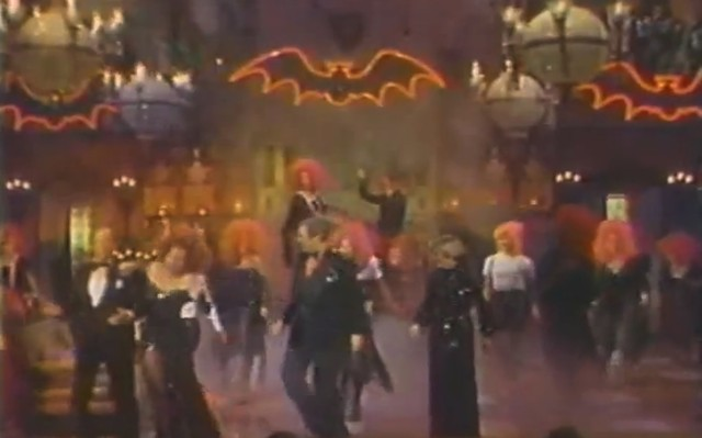 Way up in the top right corner of the frame, the members of KISS look down with scorn upon the disco-riffic proceedings below.