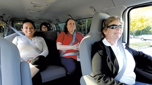 Wendy Edwards, right, drives a vanpool with Alma Greene, Jane Lolax and Laura Callahan