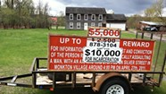 """WTF: What's the story behind that """"$10,000 Reward"""" sign in Essex Junction?"""