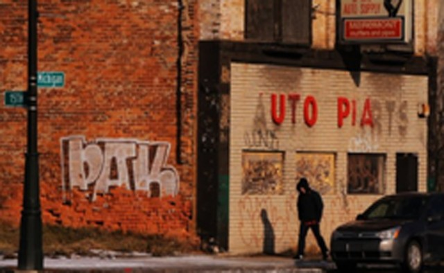 Who was responsible for the ironic message of this sign in documentary Detropia?