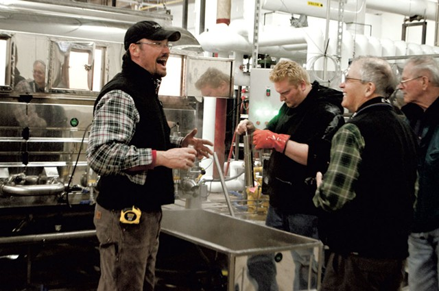 Workers monitor and test the syrup at Sweet Tree's Island Pond plant - HANNAH PALMER EGAN