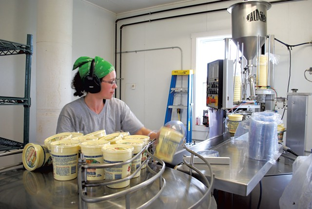 Workers processing dairy products at Butterworks Farm - KATHRYN FLAGG