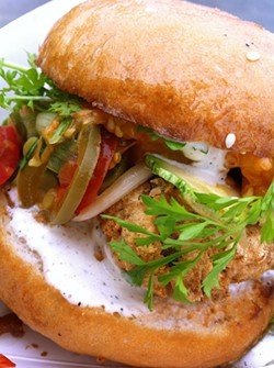 LOU BUSTAMANTE - 4505 Meats' Yum Yum sandwich combines cornmeal-crusted fried chicken with pickled vegetables.