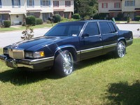 A black Cadilac Seville, similar to the vehicle carjacked today with a 5-year-old in the back seat