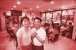 ANTHONY  PIDGEON - A Cheerful, Family-Style Place: Miss Saigon owners Huyen Tran and Timmy Nguyen.