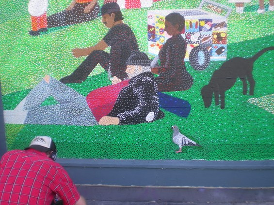 A close-up shot of Daniel Doherty's mural reveals its Seurat-inspired pointillism - GEORGES SEURAT