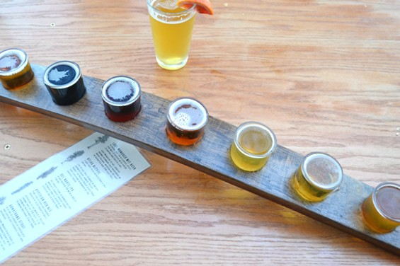 A flight of all five Fogbelt Brewing Company beers, plus two seasonals. A blood orange garnish on the Lost Monarch wheat beer is a nice touch. - ANASTASIA CROSSON