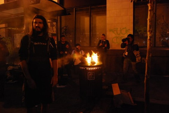 A garbage can burns -- and is documented by four photographers (including our own) - CHRIS ROBERTS