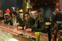 MIRAMAX FILMS - A grown-up Joseph Gordon-Levitt (left) plays a brain-damaged misfit lured into a bank heist.