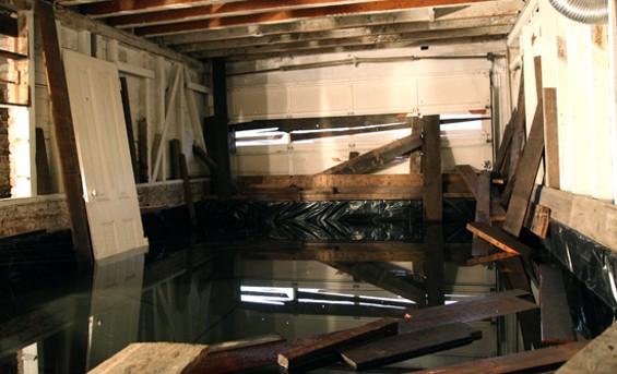 "A lagoon fills the garage at ""3020 Laguna in Exitum."" - KATE CONGER"