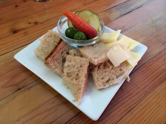 A little plate of bread, cheese and pickles came while I was waiting for my crayfish. - PETE KANE